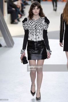 A model walks the runway at the Louis Vuitton Autumn Winter 2015 fashion show during Paris Fashion Week on March 11, 2015 in Paris, France.