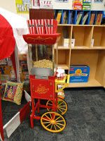 Add a popcorn machine to your circus themed classroom. The kids love it!