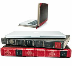 I would feel so classy and educated carrying my laptop around dressed up as an old leather-bound book!