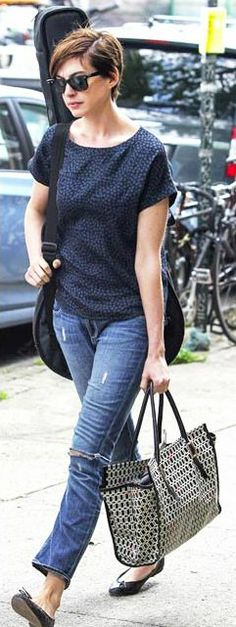 Anne Hathaway strolling through the streets of New York in our Henrietta pumps.