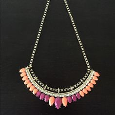 Kensie Orange And Fuchsia Necklace Kensie necklace approximately 18 inches with lobster claw closure. Can be adjusted in size. Is in a neon orange and fuchsia stoned layered necklace with rhinestones. Can be added to my middle of necklaces that are in my closet as well. Kensie Jewelry Necklaces