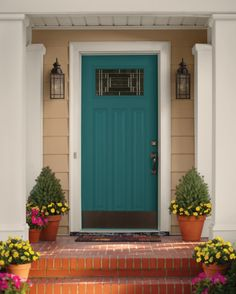 Curb appeal is a leading trend in the housing market so make your home pop with quick and easy updates. Refreshing your door with a bright and energetic paint color, adding colorful plants and new porch lighting are all wonderful ways to make a great. Teal Front Doors, Teal Door, Turquoise Door, Front Door Paint Colors, Painted Front Doors, Paint Doors, Exterior House Colors, Exterior Doors, Exterior Paint