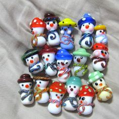 After reading Marcy's blog post about her snow folk, I was inspired to begin making my own little army of snow people for Beads of Courage....