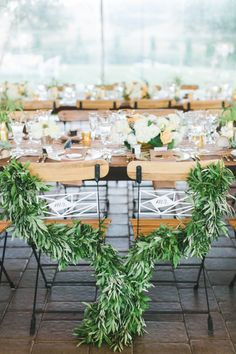 I love the way the greenery is incorporated into these chairs.  And those geometric signs are so modern.