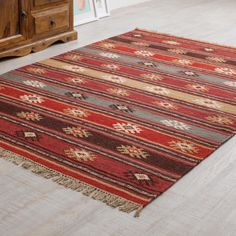 This beautiful Red Tribal Wool Kilim Rug is hand loomed using traditional techniques. Incredibly hard-wearing, available in three sizes Southwest Rugs, Morrocan Decor, Rope Rug, Teal Rug, Casual Living Rooms, Industrial, Black Rug, Textiles, Red Rugs