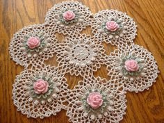 "New Handmade Pink Rose Crochet Doily ""New Handmade Pink Pin Rose Crochet Doily"", ""This doily features 6 Pink Roses surrounded by Frosty Green Leaves, Th Crochet Table Runner Pattern, Crochet Flower Patterns, Crochet Motif, Crochet Designs, Crochet Puff Flower, Crochet Flowers, Floral Flowers, Cotton Crochet, Thread Crochet"