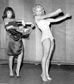 Candy Barr also must be included even with her career (which she got into because of this figure!)