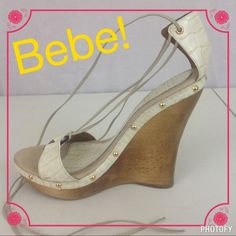 """BEBE Ivory Colored Leather Lace-up Wedges Bebe Ivory """"Crocodile"""" Lace-up Wedges. Only worn a few times. In excellent condition. Wedges are real wood. Has laces to tie around ankle or leg depending how you want to wear them! You can NOT find these anymore. So fabulous! bebe Shoes"""
