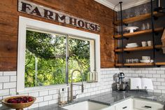 Shiplap wood was employed as paneling in the kitchen as well as elsewhere throughout this house featured on HGTV's Fixer Upper. White subway tile with dark grout offers an eye-pleasing contrast.