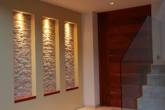 #stone wall and downward lighting and #glass stairway accents for #modern wall…