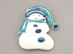 Slouchy sweet little vintage snowman. Blue Santa hat and scarf. Silvery base metal lines each feature. Christmas pin brooch jewelry.  SNO-14 by BlingItSanta on Etsy