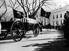 John Loengard—Time & Life Pictures/Getty Images John F. Kennedy's cortege leaves the White House, November 1963