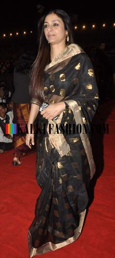 http://www.kalkifashion.com/ Tabu was seen in a black saree at 2014 Umang Police Show