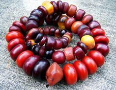 Old beads of phenolic plastic imitating amber