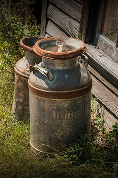 Vintage Creamery Milk Cans by the old Prairie by RandyNyhofPhotos