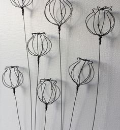 Hand formed wire 3d poppy heads on canvas