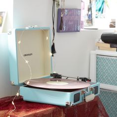 Tap to shop! // Get the tunes going in your dorm room with this lightweight, portable record player. This briefcase-style record player features three-speeds and comes in eight different colors. Put this Crosley record player on your dorm room checklist now!