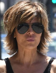 Just nipping out! Lisa Rinna shows off feminine form in revealing vest , Just nipping out! Lisa Rinna shows off feminine form in revealing vest Pucker up: She flaunted her famous trout pout as she pranced down the street. Short Hair Syles, Shaggy Short Hair, Short Shag Hairstyles, Shaggy Haircuts, Mom Hairstyles, New Haircuts, Short Hair Cuts, Shaggy Bob, Short Hair With Layers