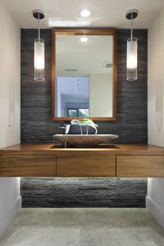 modern-tube-glass-pendant-lighting-above-wooden-bathroom-vanity-with-decorative-stoned-basin.jpg (900×1352)