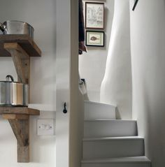 Farrow & Ball Hardwick White on the walls and Cornforth White on the wooden steps.