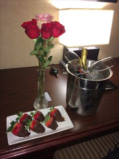 So romantic, affordable to DIY & delicious!! Bottle of wine & wine glasses, a couple/few roses in a vase (sure you have one at home or any cute container/ glass) and chocolate covered strawberries (amaretto infused would make it much more interesting) on a platter~ why didn't I ever think of that!! Hotel charged $50 extra to add this to our room.