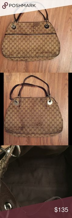 """Authentic Gucci Eclipse Bag Severe exterior stains and tears as shown in photos. The inside is in great used condition with no major flaws. The leather straps do not have any flaws. Priced per current condition. Comes with original Gucci dust bag. This medium sized shoulder bag with double strap, magnetic snap closure, exterior pocket, cell phone pocket, and inside zip pocket has timeless appeal. It features beige/ebony GG fabric, dark brown leather trim and silver hardware. Dimensions: 15""""L…"""