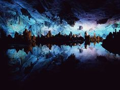 National Geographic Crystal Caves Mexico | Photo: China's Reed Flute Cave in blue light