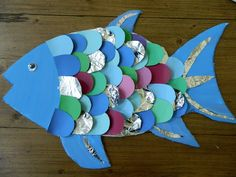 Foam board fish, painted with acrylic paint, scales made from paint chips and foil