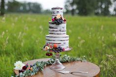 Semi naked red velvet wedding cake decorated with fresh fruit & flowers from the Handmade Cake Company. Photo: Lindsay Skeans Photography