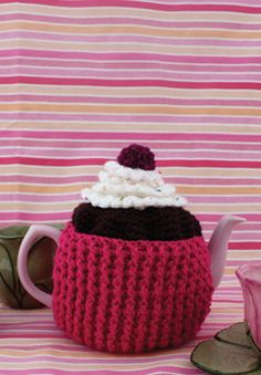 Three layers of faux-baked goodness topped off with a mini cherry pompom make this one delectable Cupcake Tea Cozy! Each layer features a different stitch, so you won't get bored.