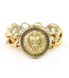Love the greek key and lion head together.