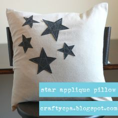 star appliqué pillow - I'd like the stars in brighter colors, or maybe even reverse applique!
