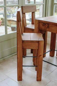 Rugged Bar Stool with rustic chunky plank design and hand waxed finish. Made to order in the UK from Curiosity Interiors, Alfreton or online at www.curiosityinteriors.co.uk Great with the Rugged Bar Table.