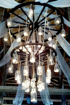 wagon wheelmason jar chandelier the heck with renting it for 700 for 1 alternating length wagon wheel mason jar