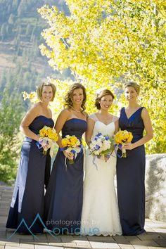 yellow flowers, navy blue bridesmaids dresses Lake Tahoe Weddings ©PhotographybyMonique.
