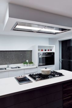 "The ""Skylight"" range hood from Futuro Futuro is a unique approach to kitchen ventilation. Flush-mounted into the ceiling, or built into a soffit, it offers powe"