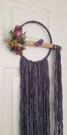 Dried gray floral dream catcher Preserved Flowers dream catchers Chiffon lace dream catcher Driftwood dreamcatcher Amethyst dream catcher  https://www.etsy.com/listing/531342681/large-floral-dream-catcher-wall-hanging