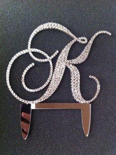 Monogram wedding cake topper covered in Swarovski crystals 5 inch. $65.00, via Etsy.