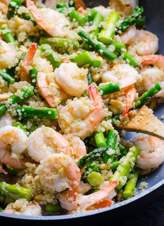 Asparagus, shrimp and quinoa stir fry with fragrant garlic and moderate amount of butter. Delicious 30 minute healthy dinner recipe.