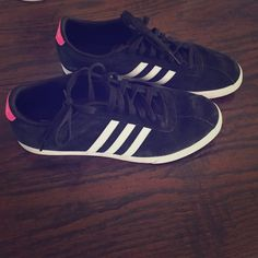 Awesome black and pink adidas sneakers Used but so cute and good condition! Women's 10.5 Adidas Shoes Athletic Shoes