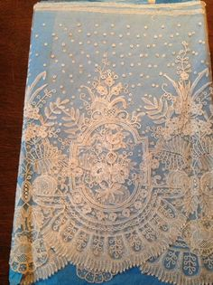 A wide Brussels bobbinlace application on machine net from the Blackborne shop, from the 4/27/2014 Ebay Alerts.