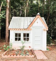 Love this landscaping around this playhouse - so cute! And the tin roof! This would be a fantastic garden shed! Build A Playhouse, Playhouse Outdoor, Painted Playhouse, Backyard Playhouse, Backyard Sheds, Outdoor Playground, Cubby Houses, Play Houses, Houses Architecture