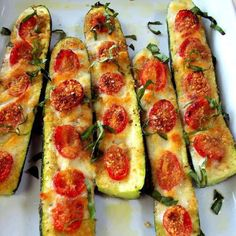 Zucchini Pizza!  Cut a zucchini in half lengthwise and the bottom so it sit still in a baking dish. Scoop out the seeds with a spoon. Brush the surface with a mixture of crushed garlic, olive oil, S&P. Arrange grape tomatoes into the grooves, sprinkle with bread crumbs and bake at 350F for about 30 minutes. Remove and place diced fontina or mozzarella in between the tomatoes, place them back in, but now under the broiler till golden and bubbling. Remove and add olive oil, parm and fresh…