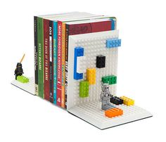 "Tired of your books falling over? Equally tired of not having Legos to play with now that you're an ""adult""?"