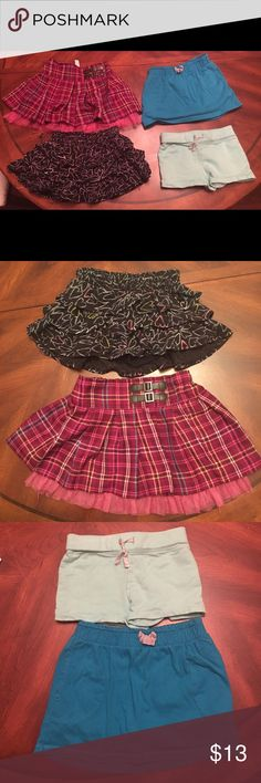 Lot of 4 Girls shorts/skirts. Maroon Plaid: Brand Cherokee and is 11.5 inches long and size is 5T. Black w/designs: Brand Circo and is 9.25inches long and is size 6/6x. Blue skirt: Brand Children's Place and is 10 inches long and size is S 5/6. Turquoise skirt: Brand is Carters and is 7 inches long and size is 5. There are no stains on anyone of them see description Bottoms Skirts