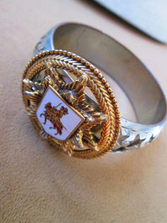 Check out this item in my Etsy shop https://www.etsy.com/listing/166720754/royal-crest-bracelet-one-of-a-kind