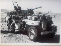 This photograph is an Imperial War Museum photo of one of the raiding jeeps which the S.A.S. used to roam the Libyan desert in 1942 (the Willys MB Jeep had become available after the U.S. entered the war in Dec. 41)  An S.A.S. jeep in the Libyan desert in 1942, armed with .5 Browning and twin Vicker's 'K' to rear and single on driver's side.