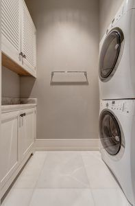 Laundry Room stackable washer dryer. Small Laundry Room with stackable washer dryer. Small Laundry Room with stackable washer dryer layout. #SmallLaundryRoom #Laundryroom #stackablewasherdryer #LaundryrooLayout Calusa Construction, Inc.