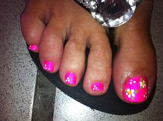 Pedicure with flower art: hot pink gel and flower art (using craft paint).