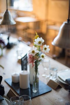 a daily something: An Autumn Table for Le Pain Quotidien x FEED Supper // black tray + white pillar candles + little vase of flowers